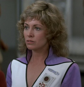 I don't normally say this about older women from the '80s with big hair... but what a stone-cold fox.  And that v-neck uniform...